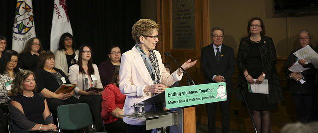 Premier Wynne presenting her Walking Together program at Queen's Park.