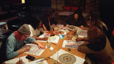 A group of adults take part in a colourful experience at Toronto's Gladstone Hotel