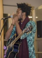 Lead singer of Kunle jams out on the harmonica