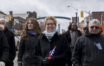 Ontario Premier Kathleen Wynne smiles into the camera.
