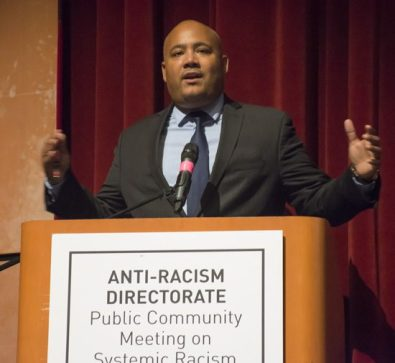 """MPP Michael Coteau, minister responsible for anti-racism, addresses the audience on the nature and goals of the directorate. He says """"anti-racism should be everyone's business."""""""