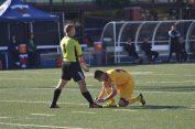 Gael's goalscorer Andrew Martin ties his goalkeeper Alex Jones's shoelace midway through the second half.