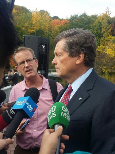 Mayor John Tory speaks with reporters.