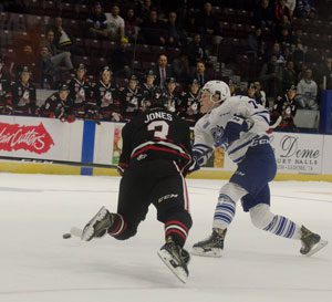 Owen Tippett, right, takes a shot in overtime with Niagara IceDogs centre, Ben Jones (3) doing all he can to get in the way. Tippett had another big game for the Steelheads with two goals and an assist. He now has four two-goal games in his past five games.