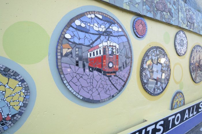 On the present apex of the mural, one of the pods depicts historical elements of East York.