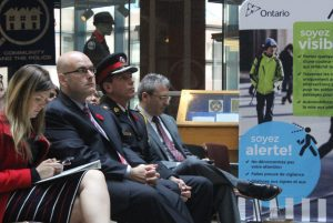 Tony Del Duca, Ontario's Minister of Transportation (second from left) and Toronto Police Superintendent Gord Jones (third from left) listen as Teresa Di Felice from the CAA talks about the importance of using more appropriate terms in road safety.