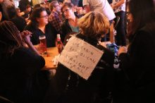 """Slogan on the back of an attendee at the Gladstone Hotel: """"Political conundrum:Log cabin Republican or straight Liberal?"""""""