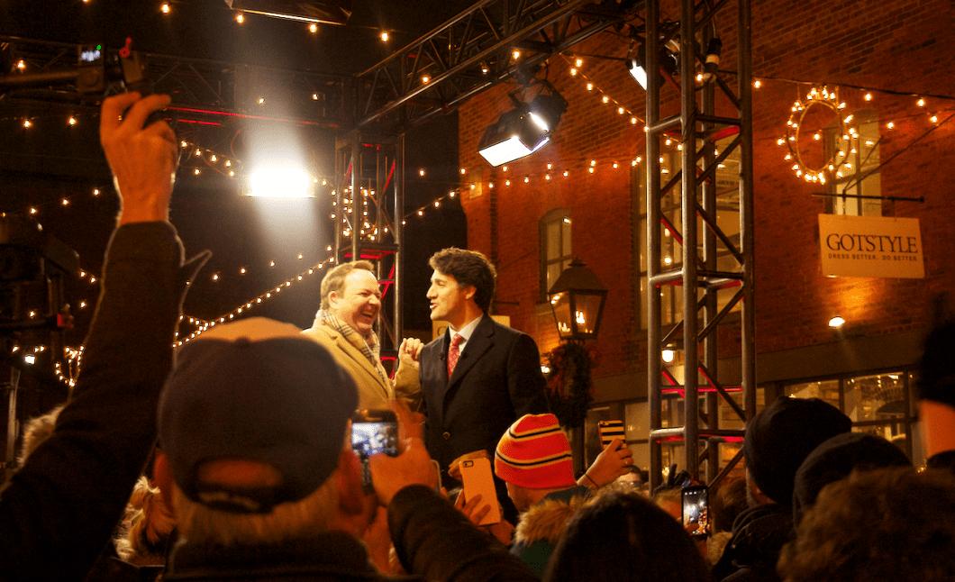 Justin Trudeau speaks with CTV weather man Tom Brown on-stage.