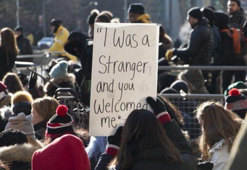 Demonstrator holding sign