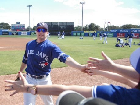 A Toronto Blue Jays player high fives fans during the game between the Toronto Blue Jays and Team Canada at Florida Auto Exchange Stadium. (Ben Holmes photo)