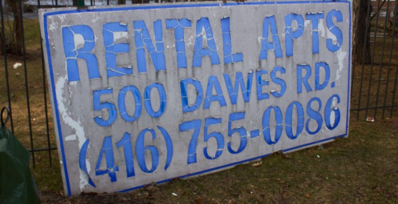 Rotting sign advertising rentals at 500 Dawes