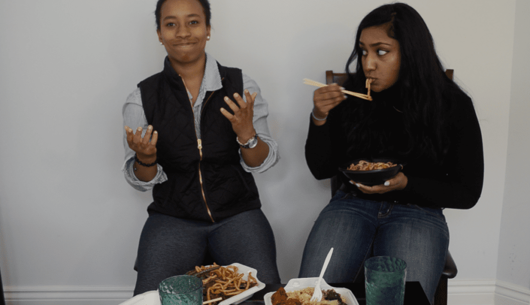 Krystal Reynolds and Melisha Ratnarajah eating