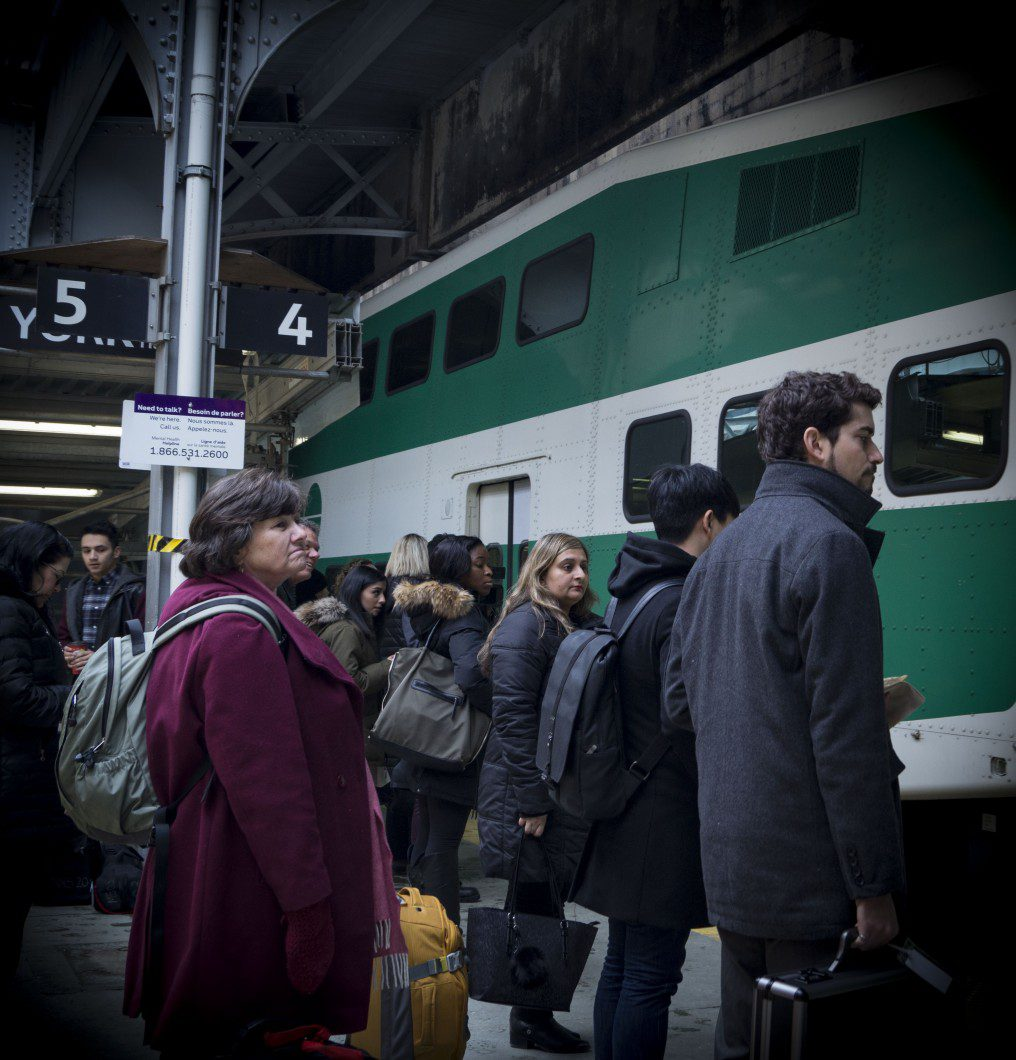 Riders getting on a GO train