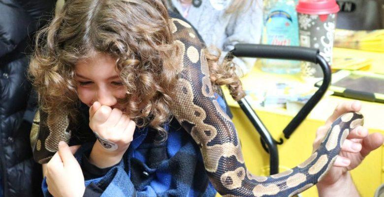 Child handling snake.