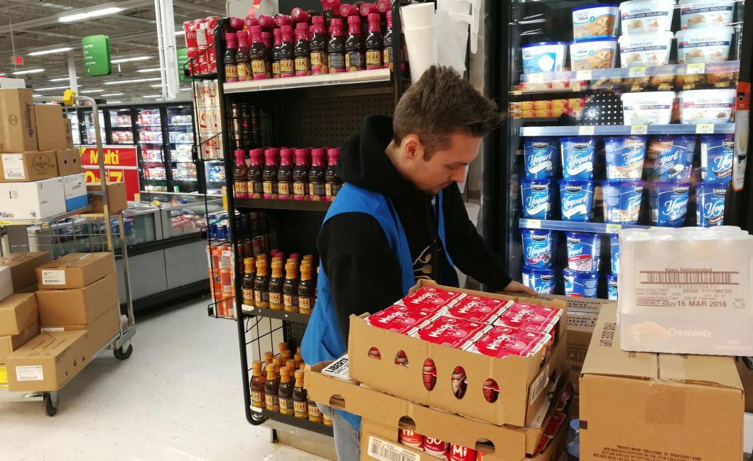Walmart employee working