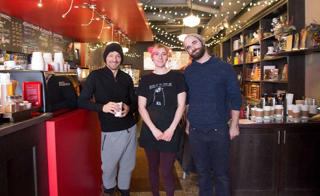 owner and baristas standing