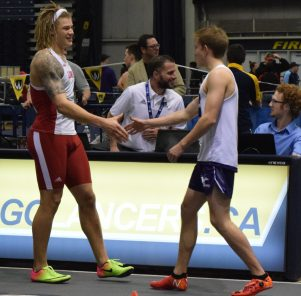 Two athletes shake hands.