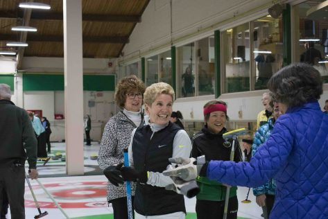 Ontario Premier Kathleen Wynne greets members of the club while on ice.