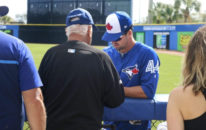 TJ House signed autographs for fans after warmups. (Ashley Taylor photo)