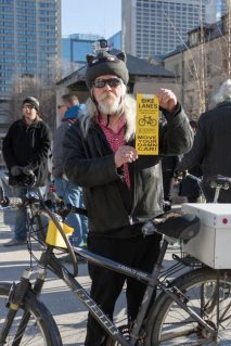 James Macfarlane, 51, at the die-in held at city hall on March 26, 2018. He has been riding for over 25 years and commutes to work on his bike all year round. He says every time drivers park in a bike lane, it endangers a cyclist.