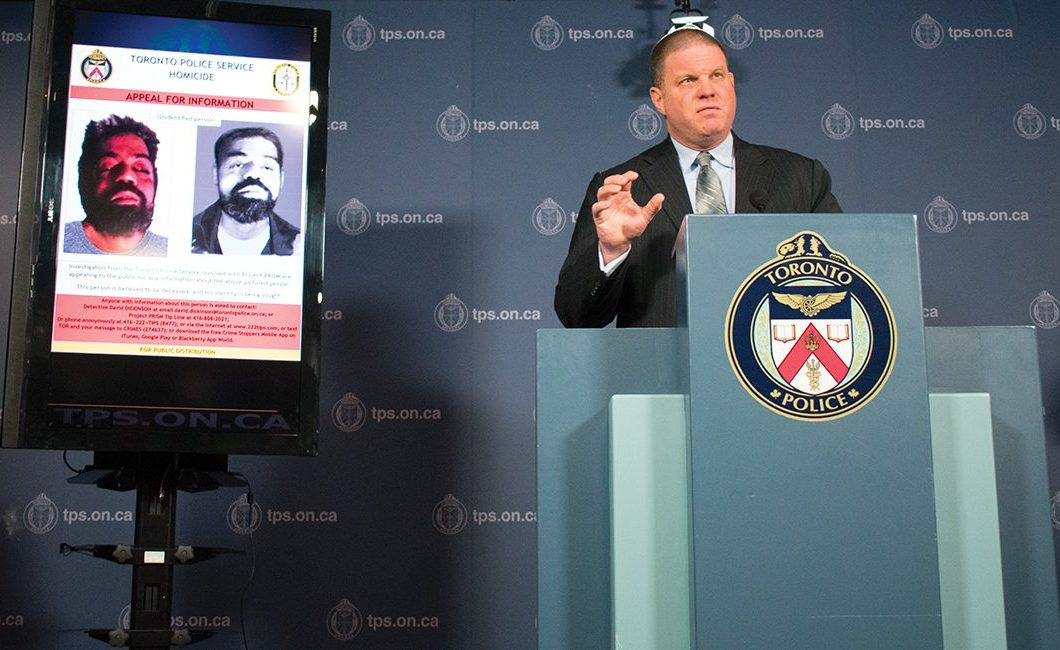 Det.-Sgt. Hank Idsinga addressing media questions beside an image and sketch of the unidentified man.