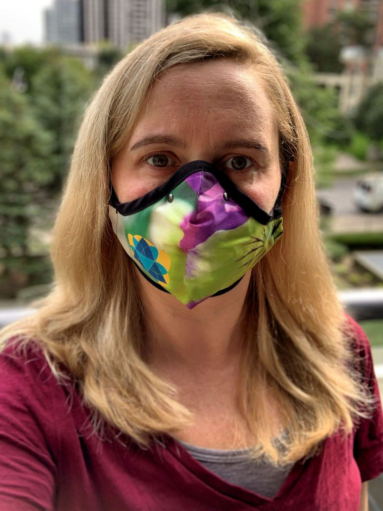 Pansy mask, designed by Toronto Alum Shireen, being modelled