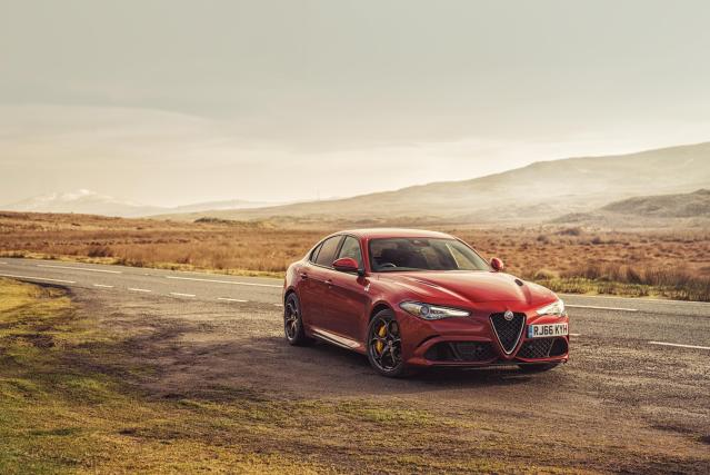 A photo of a red Alfa Romeo Giulia Quadrifoglio