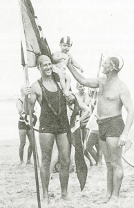 1953 Michael O'Donnell holding the Victorian flag and son of Brian Davidson, North Bondi Beach Inspector