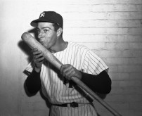 06 Oct 1950, The Bronx, New York City, New York State, USA --- Original caption: Joe DiMaggio, who saved yesterday's game for the Yanks with a great catch and won it in the 10th inning with a home run, poses at Yankee Stadium exclusively for International News Photos with the bat that did the trick. The Yankee Clipper seldom gets this affectionate with a bat and even more rarely poses for an unusual picture like this. --- Image by © Bettmann/CORBIS
