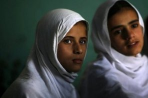 Afghan pupils attend class at a girls school in Kabul in 2010.