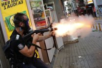 A riot policeman fires teargas during a protest in central Istanbul July 6, 2013.