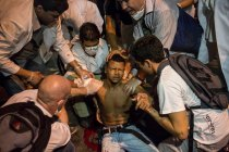 An injured demonstrator is helped by fellow protesters and treated by a doctor, left, who said the man was shot in the shoulder, during a protest in Rio de Janeiro, Brazil, Monday, June 17, 2013. AP Felipe Dana