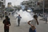Anti-government protesters demanding the ouster of Yemen's President Ali Abdullah Saleh flee after security forces fired tear gas southern city of Taiz September 19, 2011.