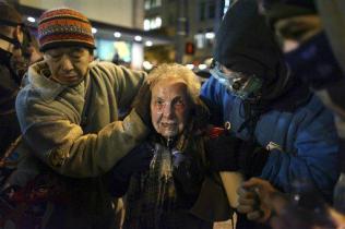 Dorli Rainey 84 year old woman being sprayed