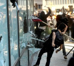 Occupy Oakland protesters smash windows at a Wells Fargo bank branch on Wednesday, Nov. 2, 2011, in Oakland, Calif.