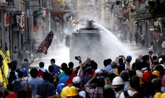 Turkish riot police use water cannon to disperse protesters during an anti-government protest at Taksim Square in Istanbul, Turkey, July 6, 2013.