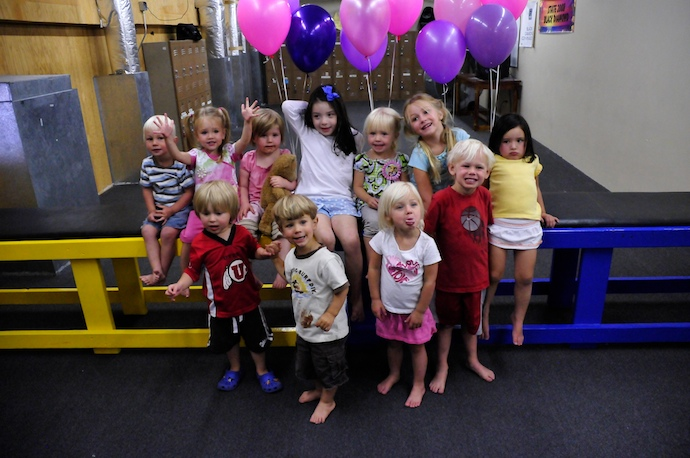 Gymnastics, balloons, and cupcakes - Must be a party!