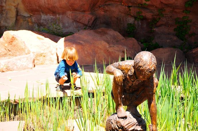 Tory kneels down in Red Butte Garden