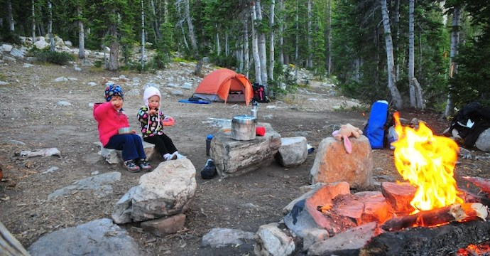 Tory and Tegan eat dinner around the campfire - Ruth Lake