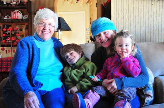Grandma Landgren gets an armload of visitors. Willmar, Minnesota.