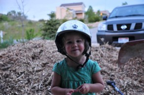 Tegan with mommy's helmet.