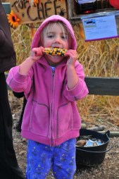 Aspen tries to eat Indian corn. Yummy. Crunchy.