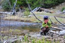 Tory poses on a log on Shingle Creek, Uintas.