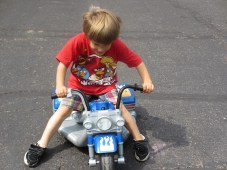 Tory rides Calebs motortrikle.