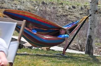 Aspen and Tai chill in the hammock