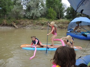 Kids begin the trip on the SUP