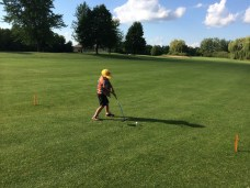 Tory lines up for a drive from the fairway.