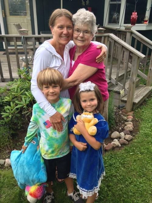 Grandma, Kari, and the kids. And their stuffed pets. Tegan got a Garfield from Grandma.