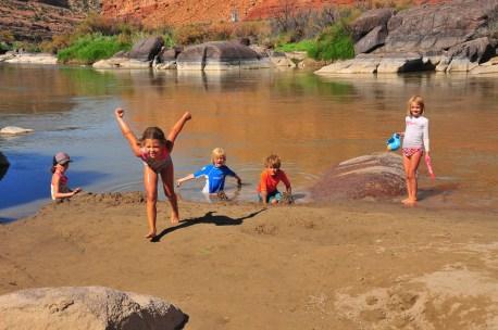 Kids make sand castles. Tegan attempts to take off.
