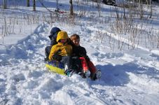 Boy pile sledding